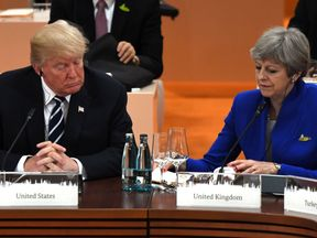 US President Donald Trump (L) and Britain's Prime Minister Theresa May attend a working session on the first day of the G20 summit in Hamburg, northern Germany, on July 7, 2017