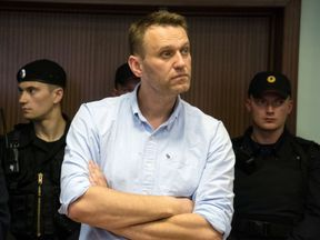 Russian jailed opposition leader Alexei Navalny attends a court hearing in Moscow on June 16, 2017. Navalny has been sentenced to 30 days behind bars after being detained on June 12 on his way to a protest in Moscow against government corruption, where hundreds were arrested in the city centre. / AFP PHOTO / Andrey BORODULIN (Photo credit should read ANDREY BORODULIN/AFP/Getty Images