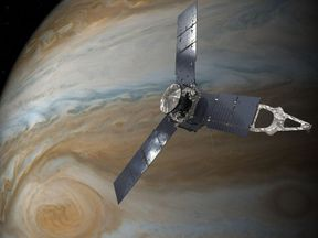 An artist's impression of Juno orbiting Jupiter. Pic NASA/JPL-Caltech