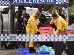 Police search for evidence at a block of flats in the Sydney suburb of Lakemba on July 31, 2017, after counter-terrorism raids across the city on the weekend. Four men accused of plotting to bring down a plane planned to use poisonous gas or a crude bomb disguised as a meat mincer, reports said, with Australian officials calling preparations 'advanced'. The men -- reportedly two Lebanese-Australian fathers and their sons -- were arrested in raids across Sydney on Saturday evening. / AFP PHOTO /