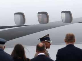 Prince George and Princess Charlotte peer out of the window as they land in Warsaw