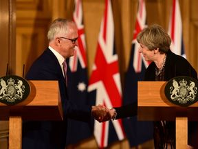 Theresa May and Australian Prime Minister Malcolm Turnbull shake hands at Downing Street