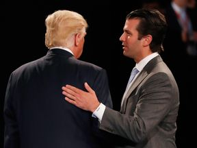Donald Trump Jr greets his father during the US election campaign in October last year