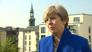 Theresa May has struck a conciliatory note to business leaders who have demanded that Britain stays in the Customs Union.