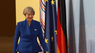 Theresa May arrives at the start of the G20 summit