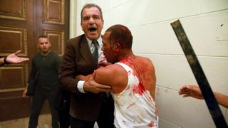 Opposition lawmaker Luis Stefanelli (C) holds an injured government supporter