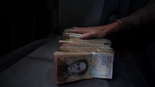 Hyperinflation in Venezuela means large amounts of cash to buy basic items