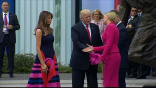 Donald Trump misses handshake with Polish president's wife
