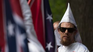 A Klan member looks on during protests in Virgina