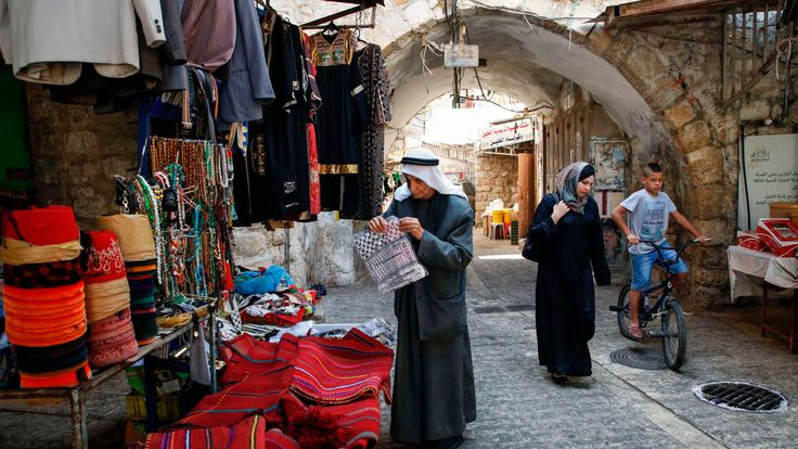 A Palestinian man in an alley in the old market of the town