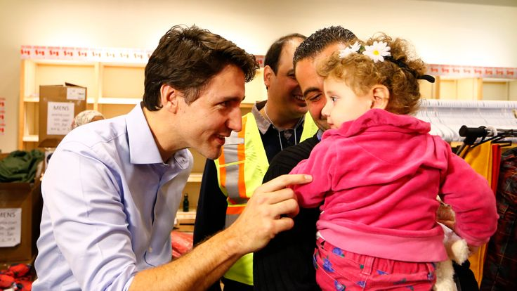 Justin Trudeau meets Syrian refugees arriving in Toronto