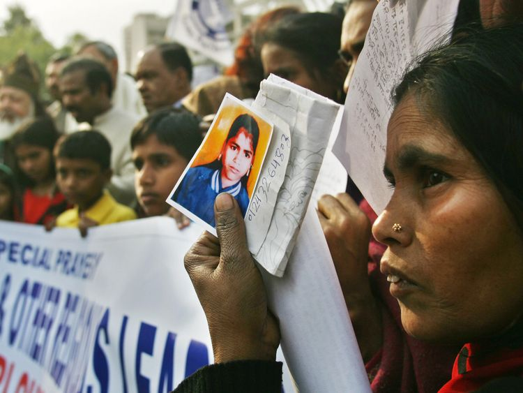 Relatives of missing children at a prayer meeting near Pandher's house in 2007