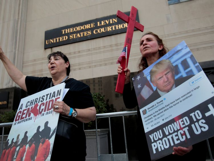 Protesters demonstrate outside a court hearing to halt the deportation of 1,400 Iraqi nationals. (file photo)  Protesters rally outside the federal court just before a hearing to consider a class-action lawsuit filed on behalf of Iraqi nationals facing deportation, in Detroit, Michigan, U.S., June 21, 2017. REUTERS/Rebecca Cook
