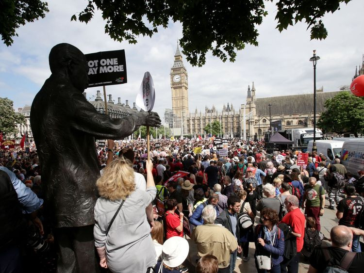People converge on Parliament Square after marching through London in an anti-austerity protest
