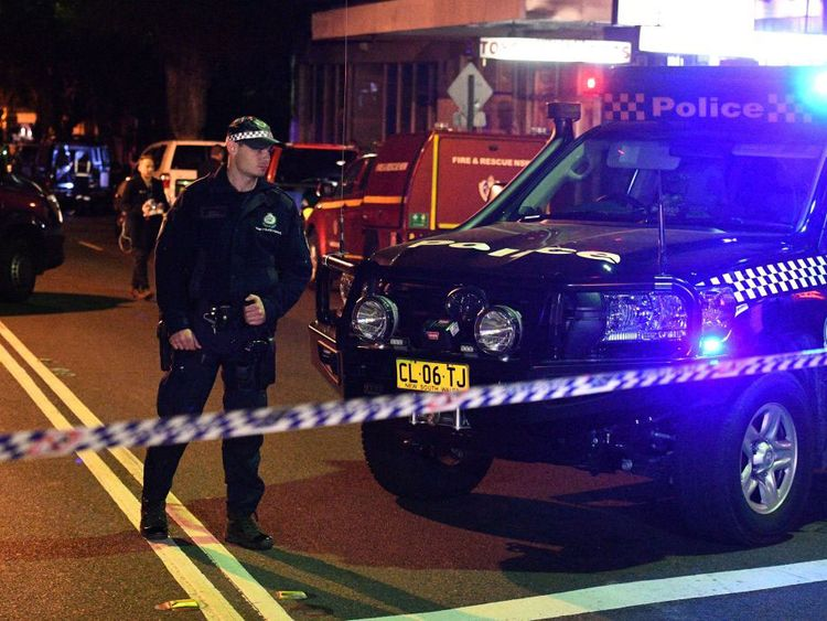 Police at a check point in the Sydney inner suburb of Surry Hills where raids took place