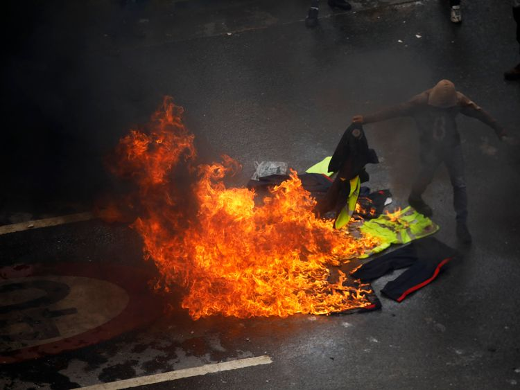 Demonstrators burn police uniforms