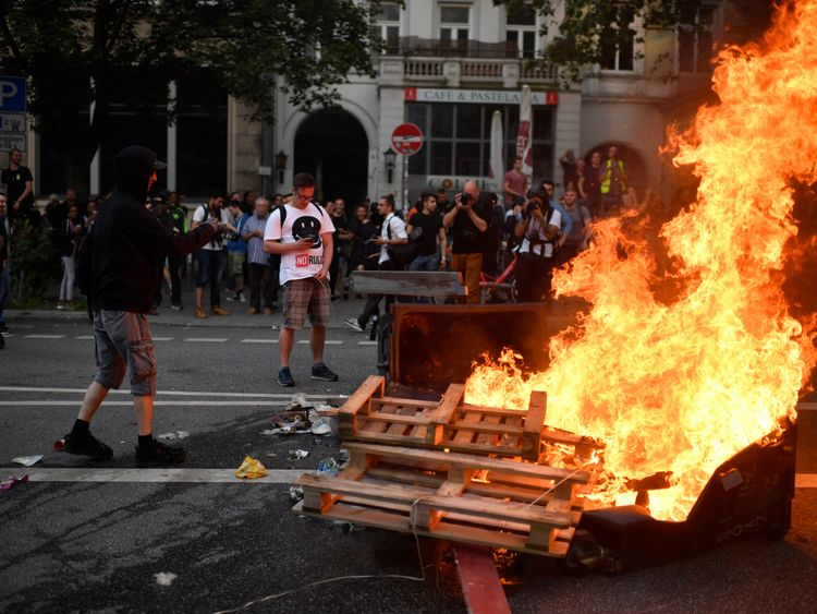 Protesters burn barriers outside the G20