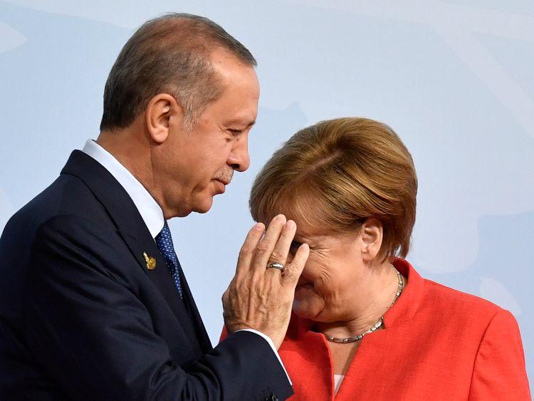 German Chancellor Angela Merkel greets Turkey's President Recep Tayyip Erdogan