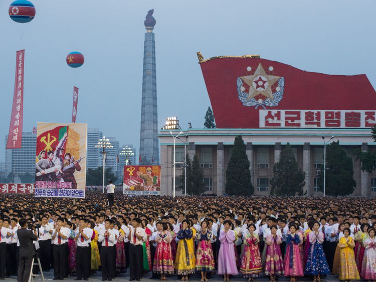 North Koreans celebrate the launch of an intercontinental ballistic missile