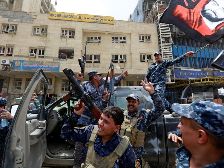 Iraqi Federal Police celebrate in the Old City of Mosul