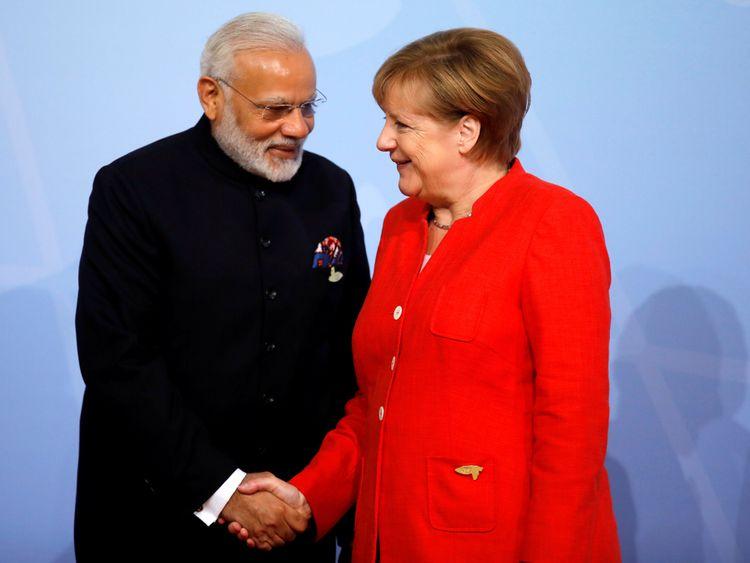 German Chancellor Angela Merkel welcomes India's Prime Minister Narendra Modi