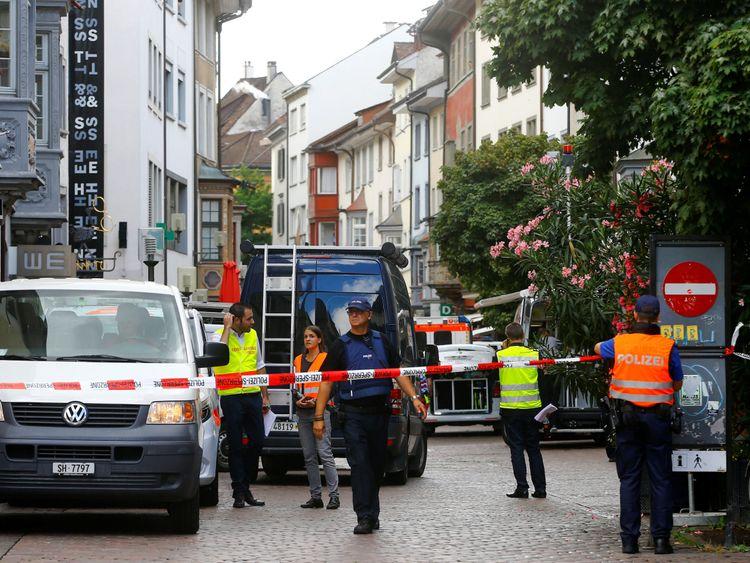 Swiss police officers stand at a crime scene in Schaffhausen, Switzerland