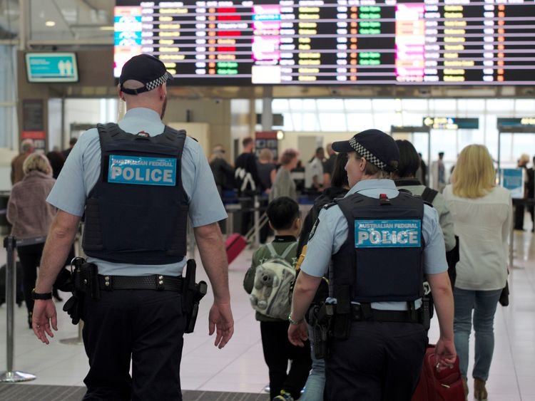 Australia Federal Police officers patrol the security lines at Sydney's Domestic Airport in Australia...