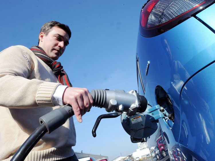 Electric cars require recharging, often at publicly available ports.