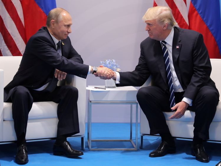 U.S. President Donald Trump shakes hands with Russia's President Vladimir Putin during their bilateral meeting at the G20 summit in Hamburg