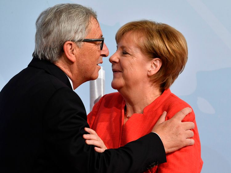 German Chancellor Angela Merkel greets the President of the European Commission Jean-Claude Juncker
