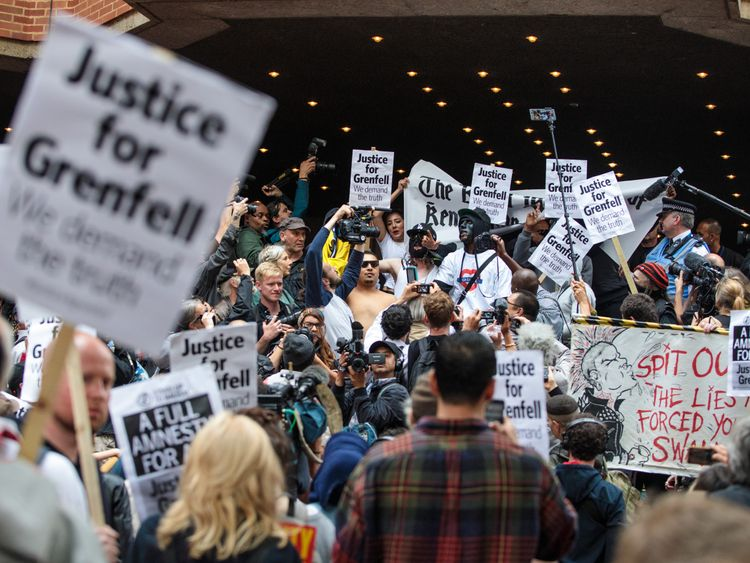 Protesters demonstrate outside the first full Kensington council meeting held since the Grenfell Tower fire which claimed at least 80 lives