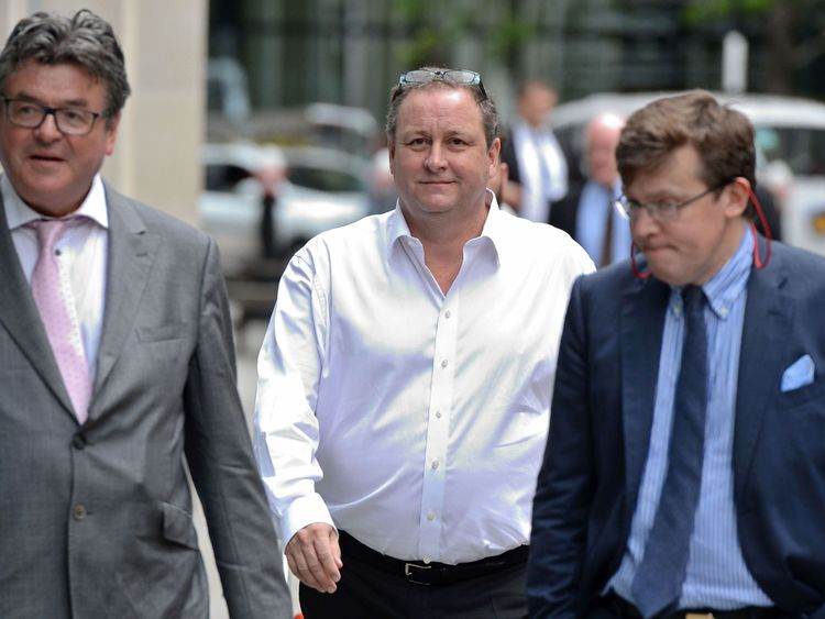 The billionaire (centre) pictured arriving at the court in central London