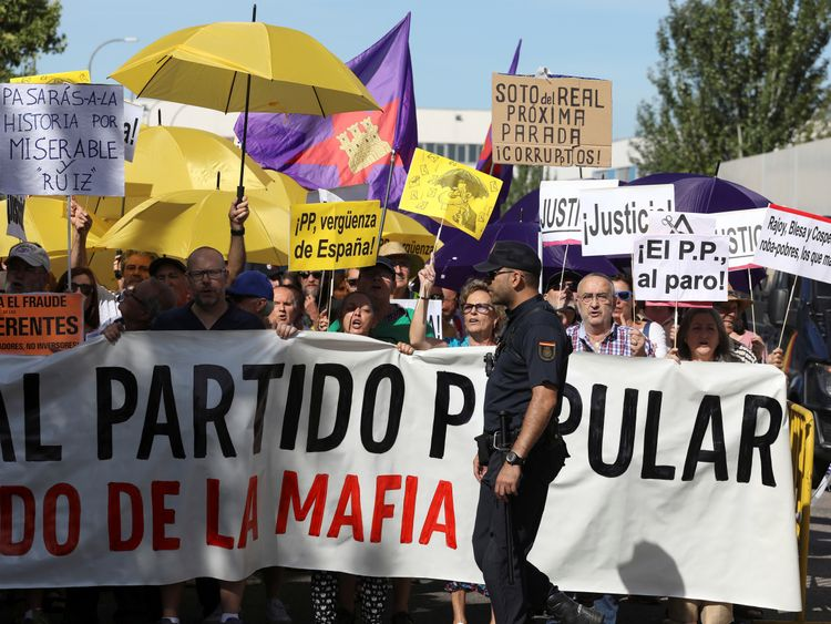 Dozens of people protested outside the courthouse as Mr Rajoy gave evidence