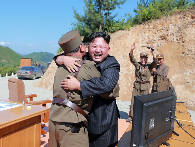 Kim Jong-Un celebrates the ICBM launch with military officers