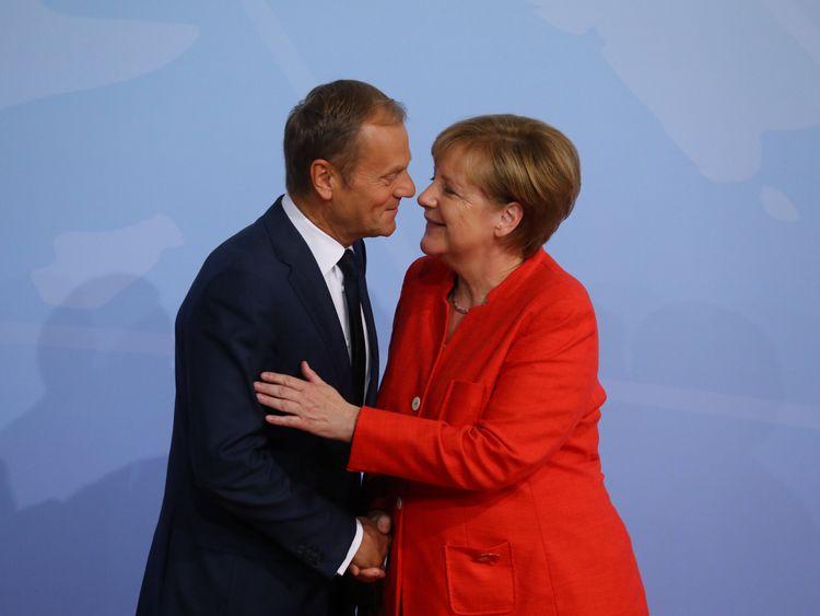German Chancellor Angela Merkel greets European Council President Donald Tusk