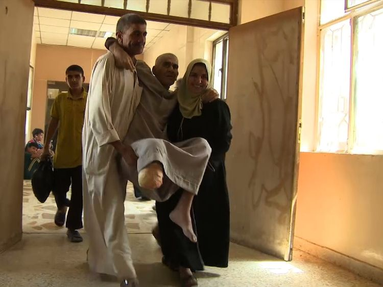 An man injured in the fighting is carried into the hospital