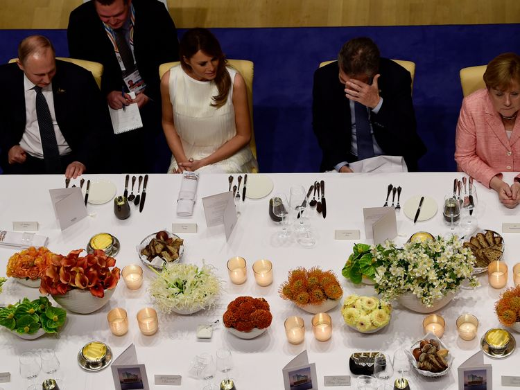 Mr Putin sat next to Melania Trump at a G20 banquet, with Angela Merkel on the right