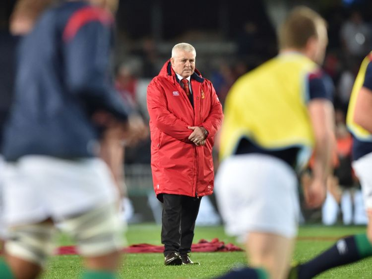 British and Irish Lions coach Warren Gatland watches his team warm-up before the third rugby union Test match between the British and Irish Lions and New Zealand All Blacks at Eden Park in Auckland on July 8, 2017