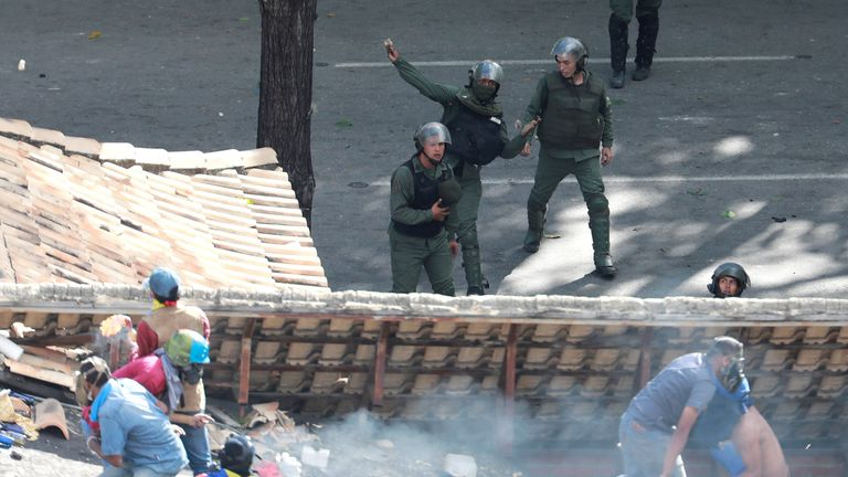 Demonstrators and riot security forces clash