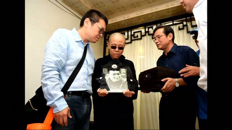 Liu Xiaobo's wife Liu Xia holds a photo of her late husband