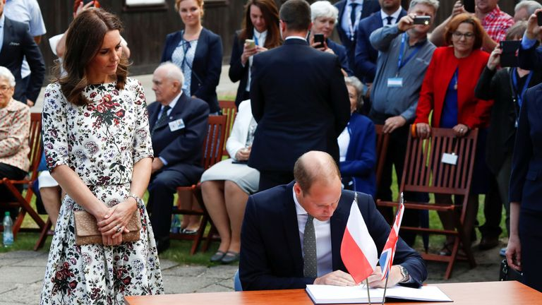 Prince William, the Duke of Cambridge Cambridge signs the book of visitors at the museum of former German Nazi concentration camp Stutthof in Sztutowo