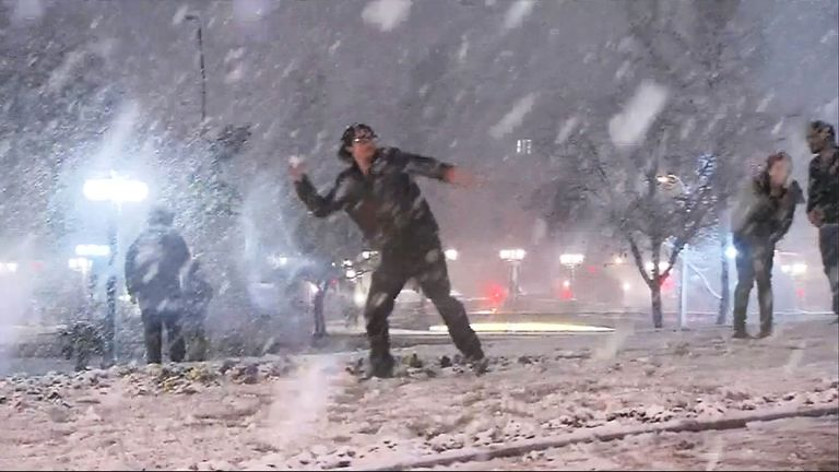 Chile: Santiago residents come out to play as rare snowfall blankets capital. Pic grab from RTV