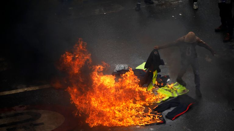 Demonstrators burn police uniforms