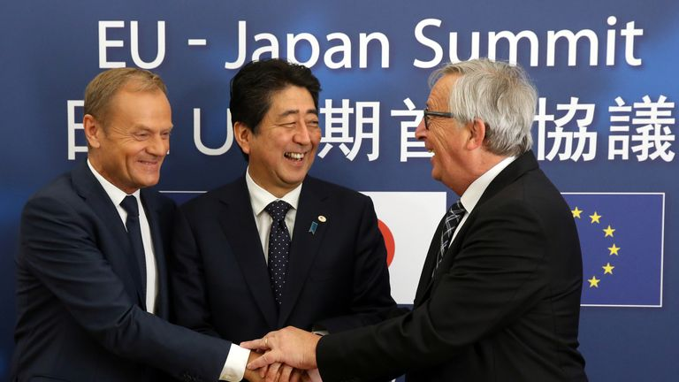 Donald Tusk, Shinzo Abe and Jean-Claude Juncker are all smiles
