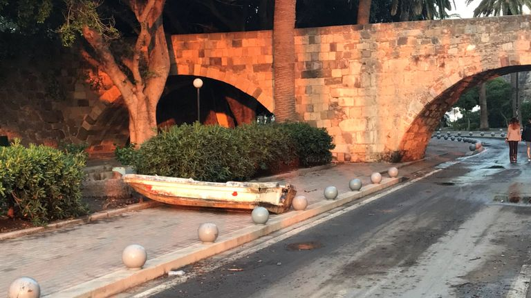 A boat rests on a sidewalk after a quake in Kos, Greece