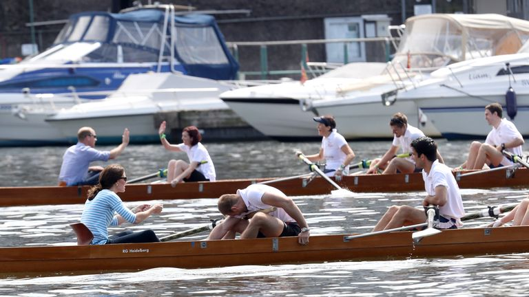 The Duke and Duchess of Cambridge take part in a rowing race