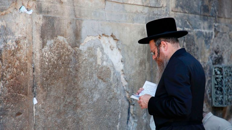 An ultra-Orthodox Jew prays outside the Tomb of the Patriarchs