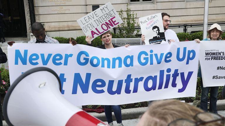 Proponents of net neutrality protest against Federal Communication Commission Chairman Ajit Pai outside the American Enterprise Institute