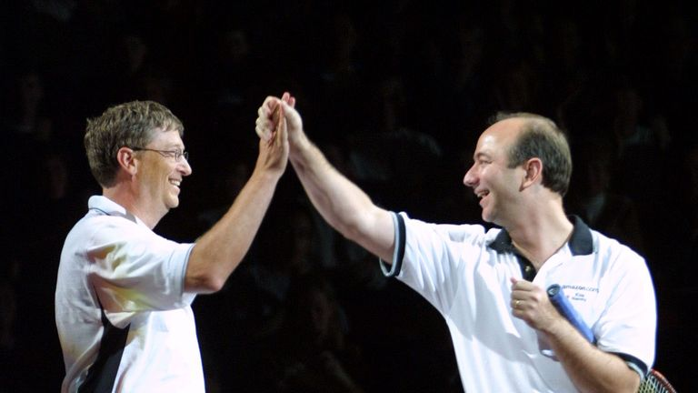 Not just rivals in business. Jeff Bezos and Bill Gates play tennis in 2001.