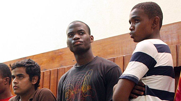 This photo taken on November 23, 2010 shows Michael Adebolajo (C) among the nine suspected members of the Al-Shabaab Movement arrested by Kenyan police on November 22 on claims of being Al-Shabaab recruits on their w
